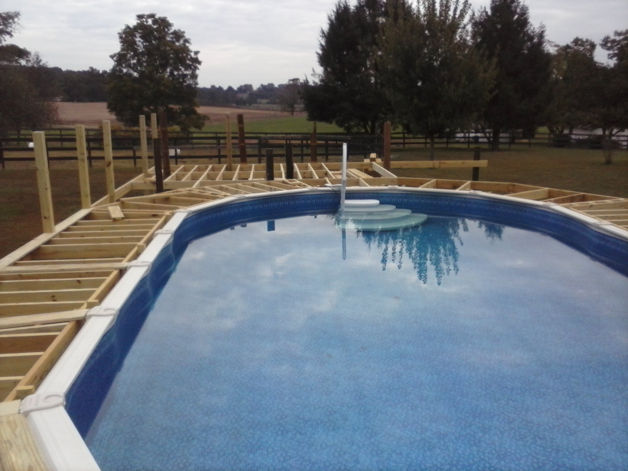 building the deck frame around the swimming pool