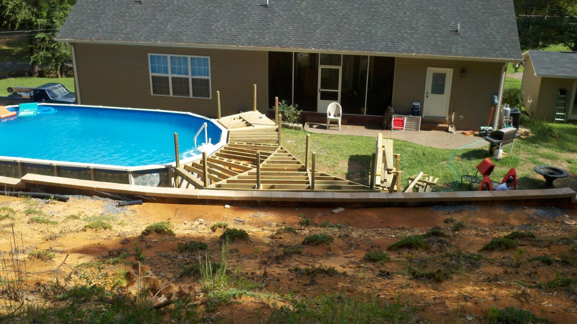 framing the deck around the swimming pool