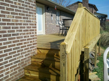 one of four sets of steps on the deck