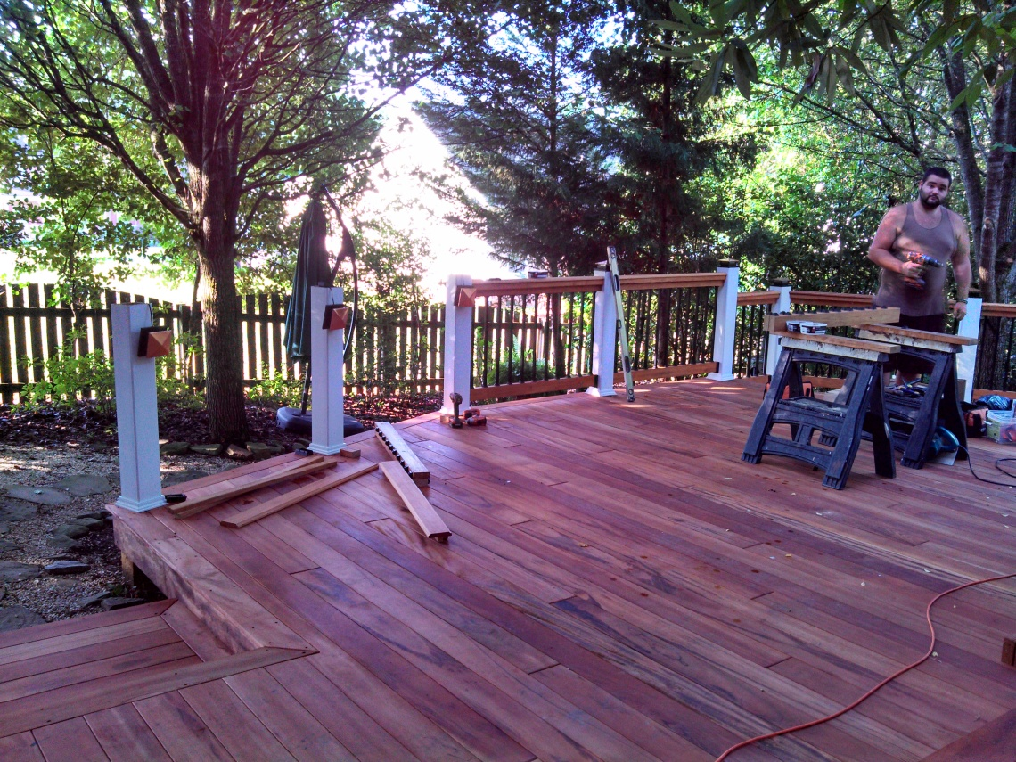 tigerwood deck with handrails being built