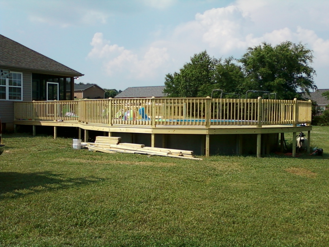 Deck around a swimming pool in Kodak, TN built by The Deck Builder.