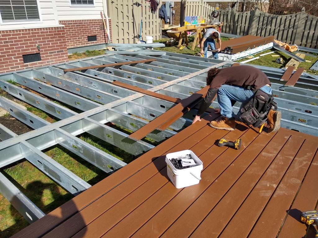 Deck builder installing trex decking