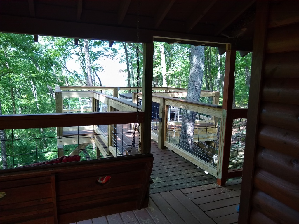 View of the back deck with hogwire railing and a hot tub on the deck